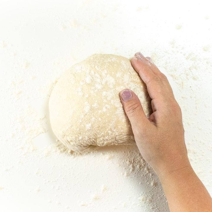Pizza dough in a ball.