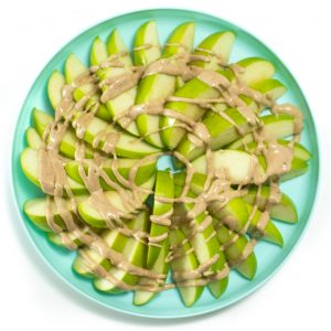 apple slices with healthy caramel sauce swirled on top.