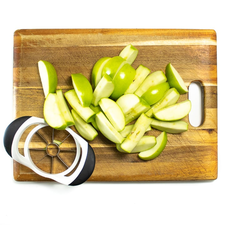 cutting board with apple slices on it.