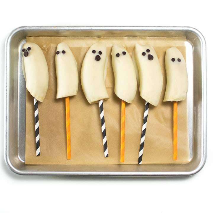 Tray of frozen ghost bananas for toddler and kids.