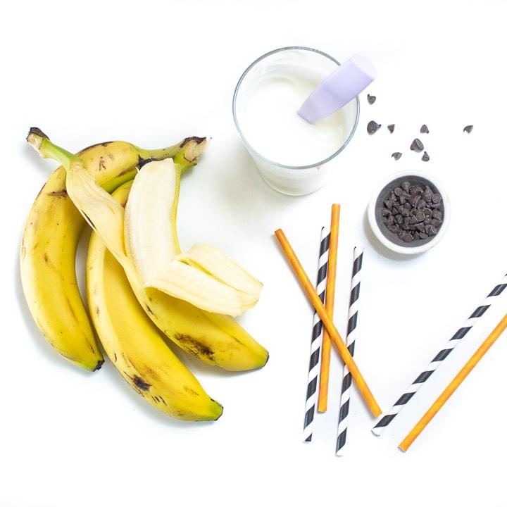 Spread of ingredients for frozen ghost bananas.