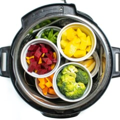 Instant pot filled with ramekins filled with fruits and vegetables for baby food.