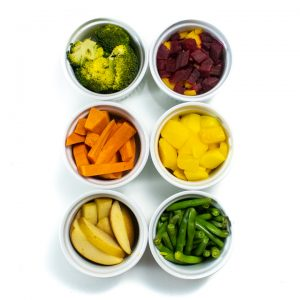 6 ramekins with different fruits and vegetables for baby food.