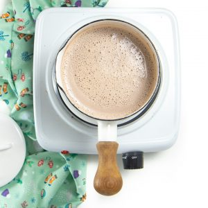 Small saucepan with warm hot chocolate ready to serve.