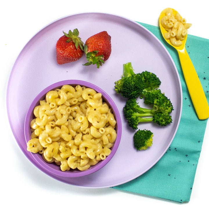 Purple kids dinner plate with an easy instant pot Mac and cheese with healthy sides.