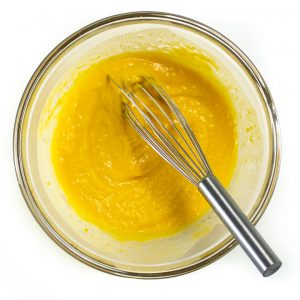 Pumpkin puree and milk whisked together for biscuits.