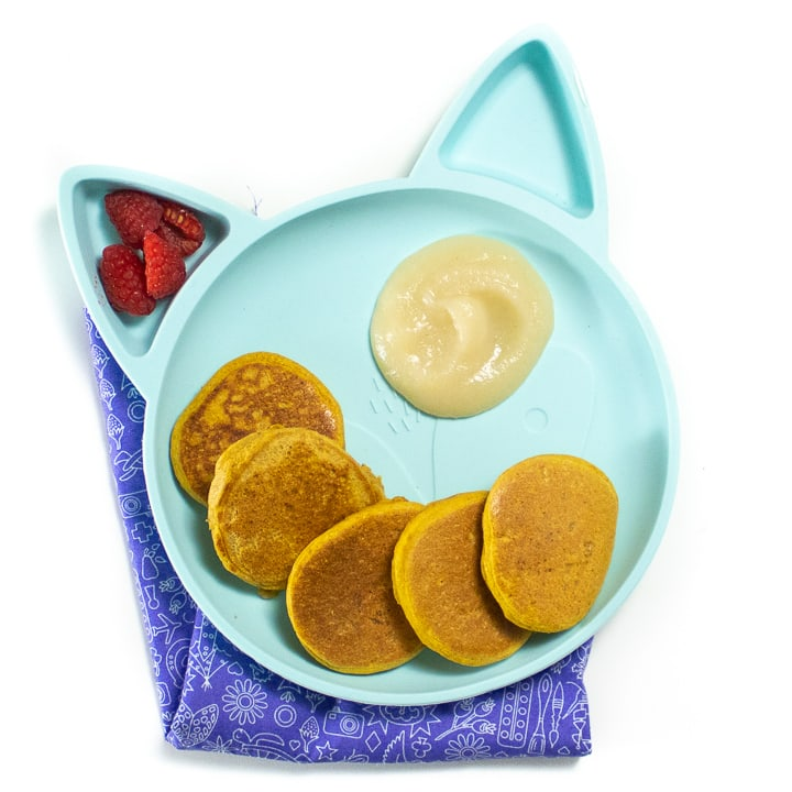 Plate of pumpkin pancakes with a pear dipping sauce.