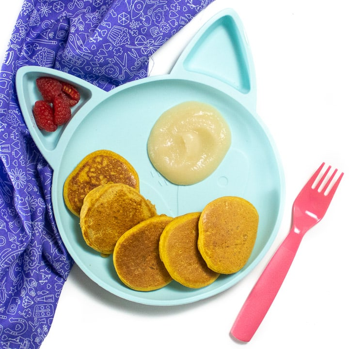 Plate of pumpkin pancakes with a pear dipping sauce great for baby or toddler.