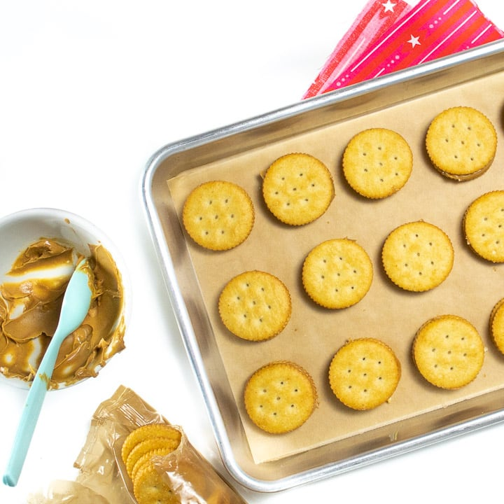 Sheet pan of ritz crackers and peanut butter.