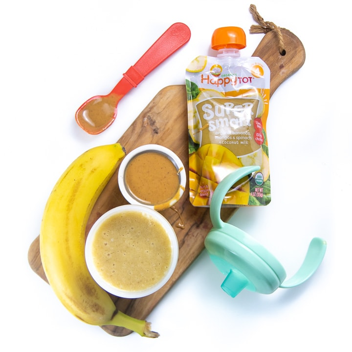 Cutting board with healthy ingredients to make smoothie for baby.