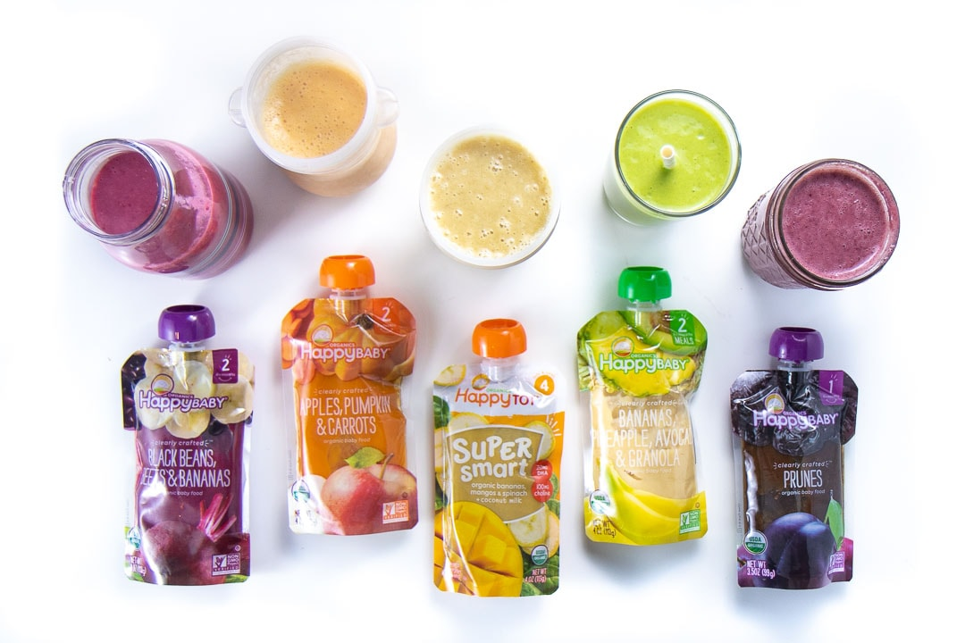 5 colorful smoothies lined up with the baby food pouches that I used to make them.