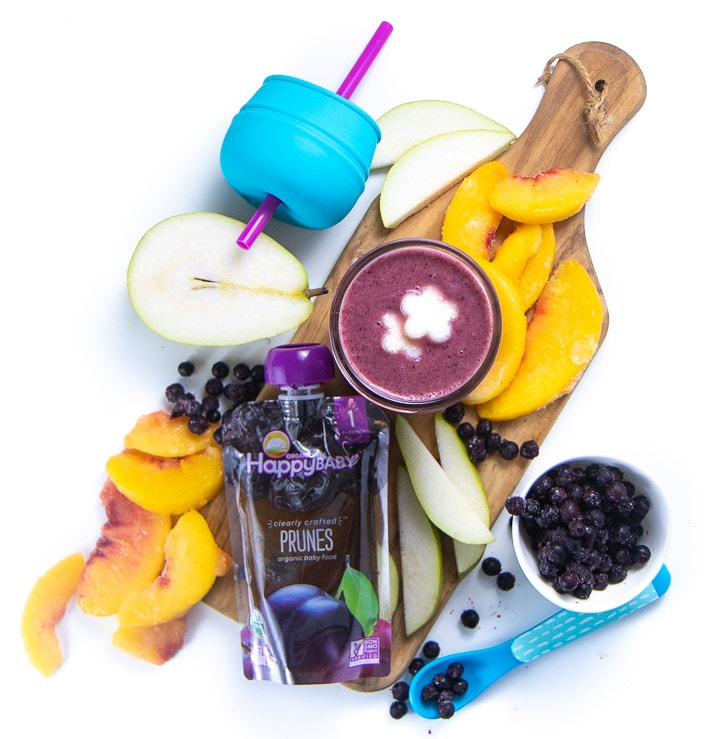 Cutting board with a spread of healthy ingredients for a smoothie for baby and toddler.