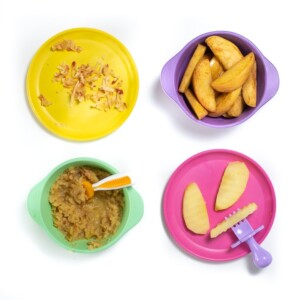 4 colorful bowls and plates with 4 different ways to serve apples to baby.