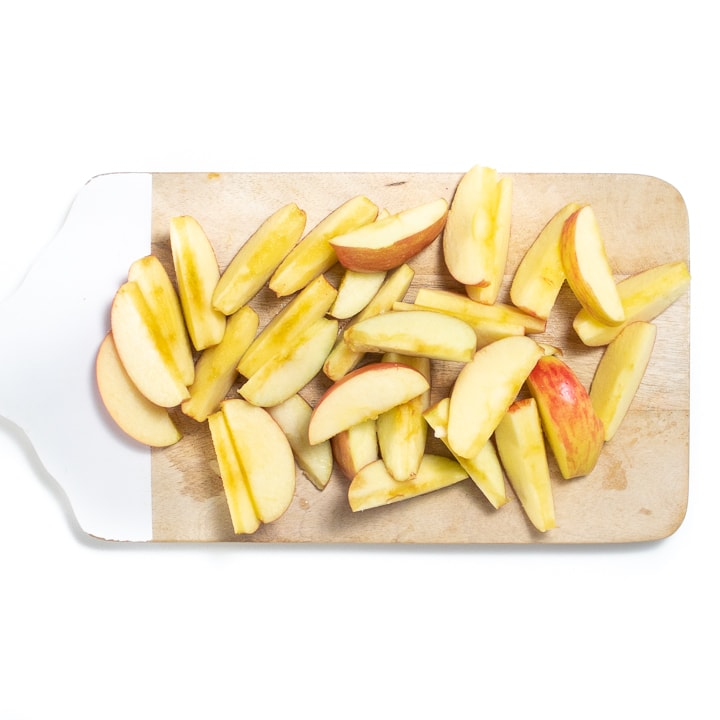 cutting board with apple chunks