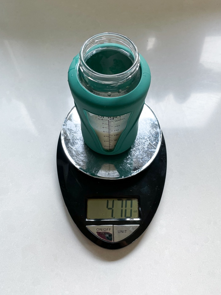 scale with a bottle on it made by hand.