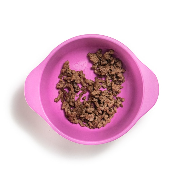 Pink bowl with ground beef.