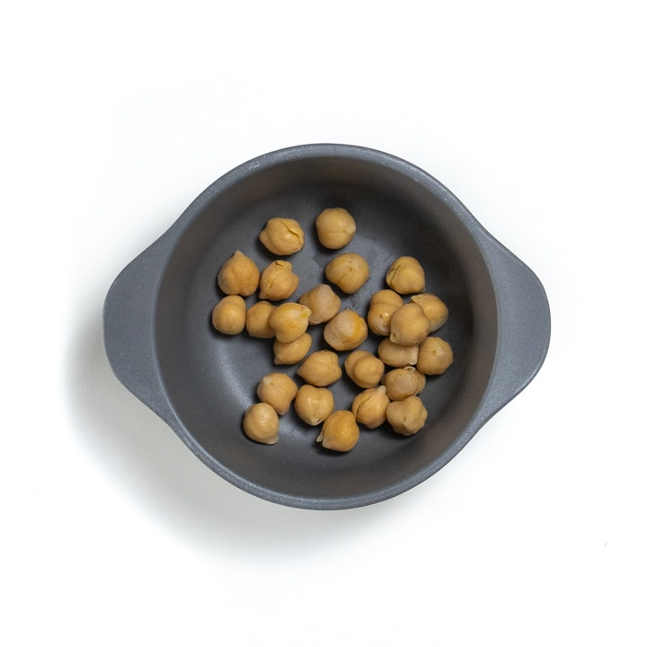 Gray bowl filled with chickpeas.