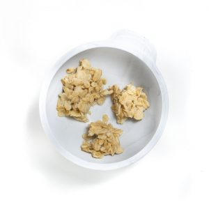 Gray baby bow with chunks of oatmeal for baby.