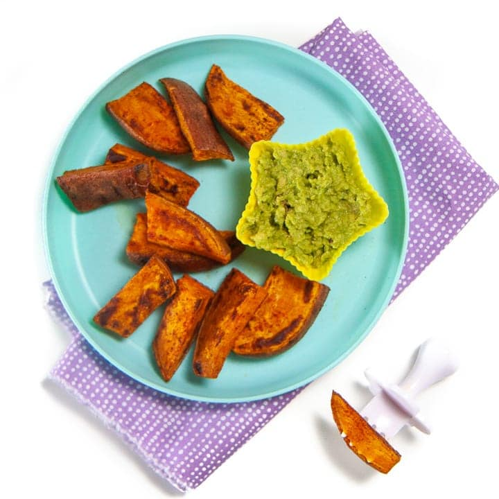 Teal plate with sweet potato wedges for baby.