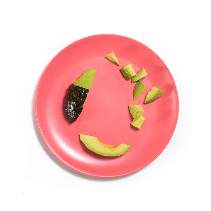 Avocado on a plate 3 different ways.