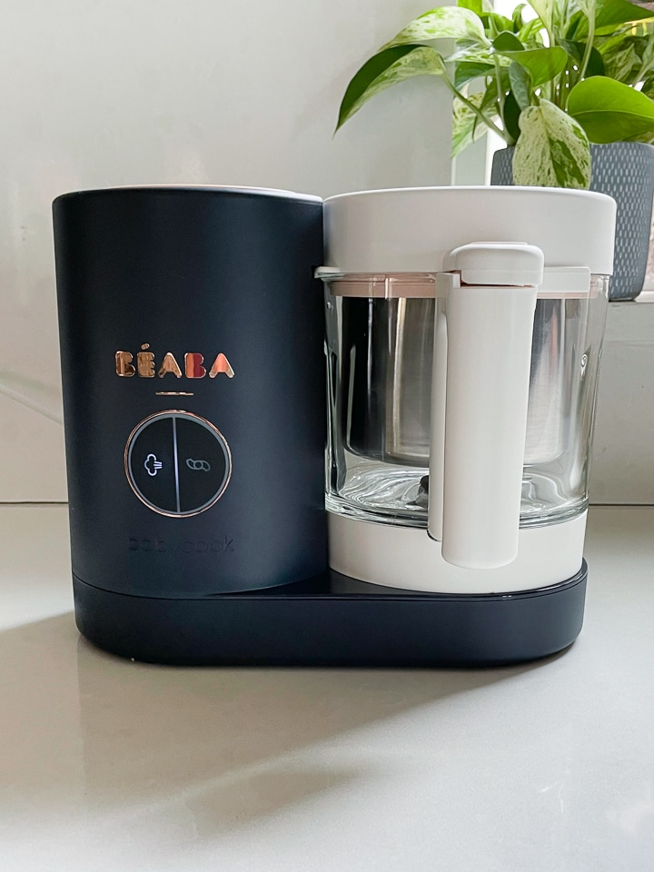 Up close shot of a Beaba babycook with the steam light on.