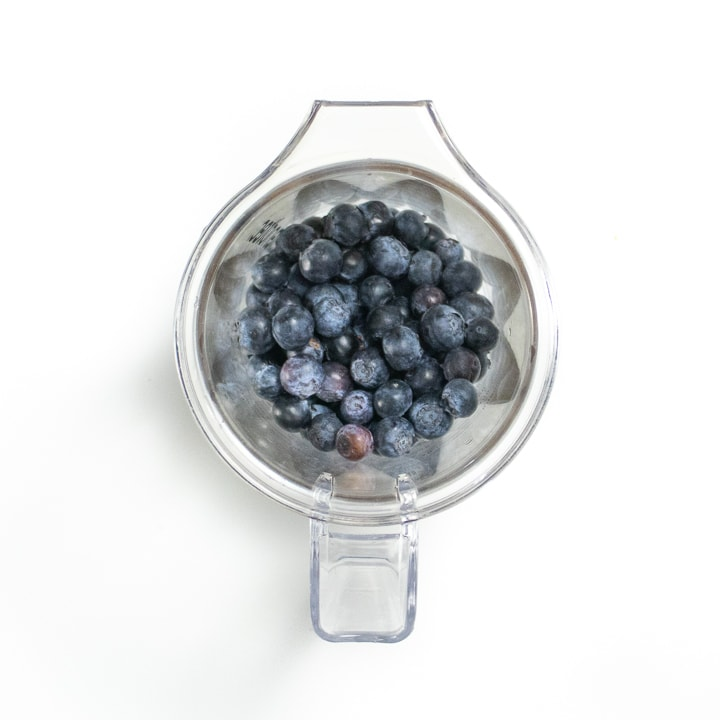 blender full of blueberries.